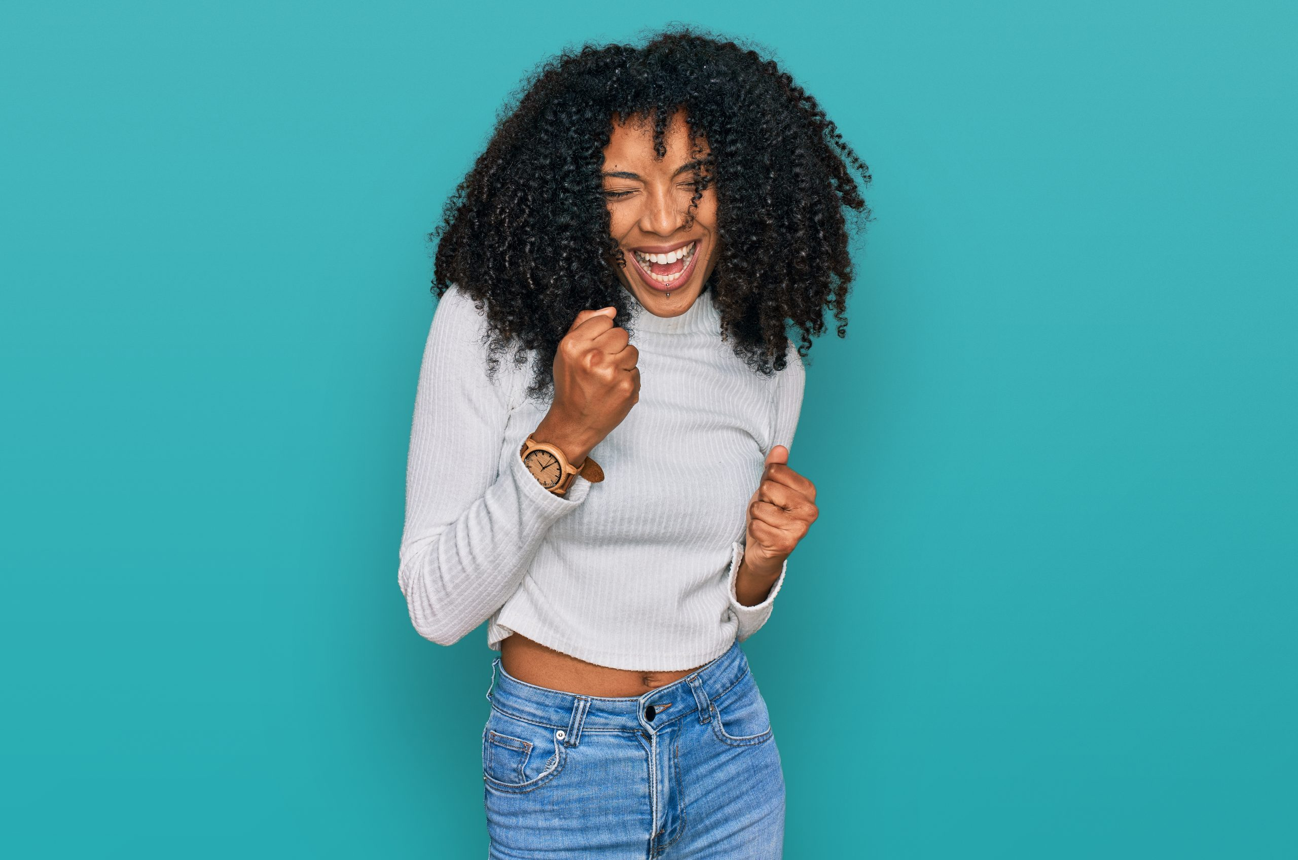 Young african american girl wearing casual clothes celebrating surprised and amazed for success with arms raised and eyes closed. winner concept.